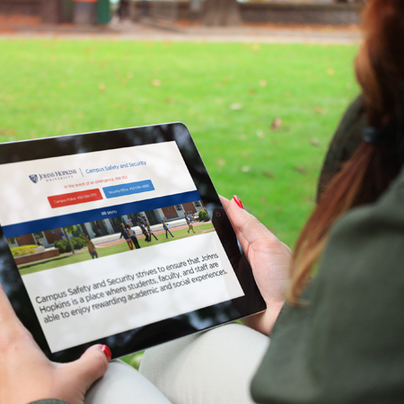 Student using Campus Safety website on tablet