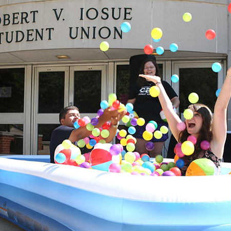 Example photo o students playing a ball pit