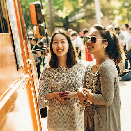 Students at a food truck event