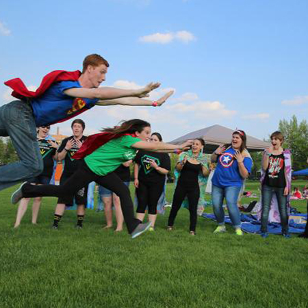 Example photo of students in super hero-themed race